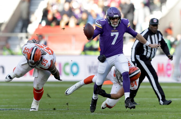 Minnesota Vikings quarterback Case Keenum (7) scrambles away from Cleveland Browns nose tackle Danny Shelton during first quarter of an NFL football game at Twickenham Stadium in London, Sunday Oct. 29, 2017. (AP Photo/Tim Ireland)