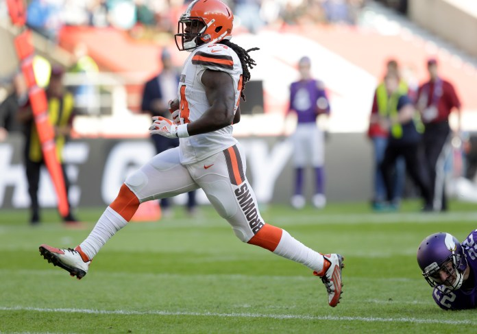 Cleveland Browns running back Isaiah Crowell (34) races into the end zone to score a 26-yard touchdown run during an NFL football game against Minnesota Vikings at Twickenham Stadium in London, Sunday Oct. 29, 2017. (AP Photo/Tim Ireland)