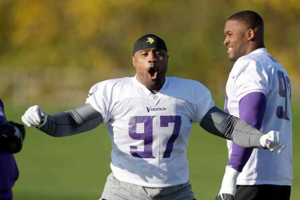 Minnesota Vikings defensive end Everson Griffen reacts to music being played as he takes part in an NFL training session at the London Irish rugby team training ground in the Sunbury-onThames suburb of south west London, Friday, Oct. 27, 2017. The Minnesota Vikings are preparing for an NFL regular season game against the Cleveland Browns in London on Sunday. (AP Photo/Matt Dunham)