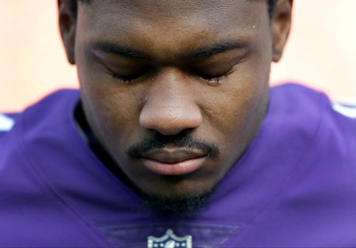 Minnesota Vikings wide receiver Stefon Diggs pauses during the singing of the The Star-Spangled Banner before an NFL football game against the Cleveland Browns at Twickenham Stadium in London, Sunday Oct. 29, 2017. (AP Photo/Matt Dunham)