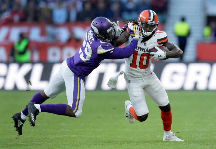 Cleveland Browns wide receiver Sammie Coates (10) runs with the ball as Minnesota Vikings cornerback Xavier Rhodes, left, defends during the second half of an NFL football game at Twickenham Stadium in London, Sunday Oct. 29, 2017. (AP Photo/Tim Ireland)