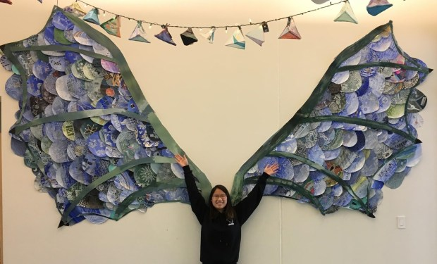 Kira Peterson, a student at Lakes International Language Academy in Forest Lake, poses with dragon wings in October 2017. (Courtesy of Shannon Peterson)