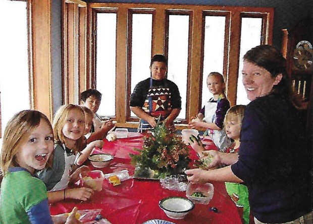 Holiday bakers are, from left, Nadine Marty, Carley Marty, Jack Nevitt, Jamie Nevitt, Emmy Leeson, Riley Marty and Jessica Anderson. (Courtesy of Joanne Flueger Anderson)