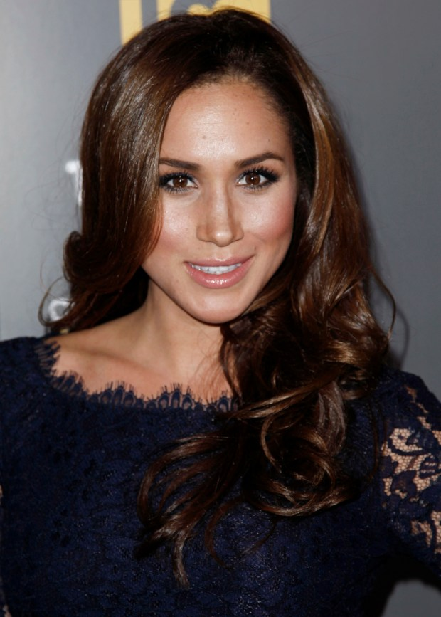 "In this Wednesday, Feb. 15, 2012 photo, Meghan Markle arrives at USA Network and The Moth's ""A More Perfect Union: Stories of Prejudice and Power"" Characters Unite storytelling event in West Hollywood, Calif.. Palace officials announced Monday Nov. 27, 2017, Prince Harry and Meghan Markle are engaged, and will marry in the spring. (AP Photo/Matt Sayles)"