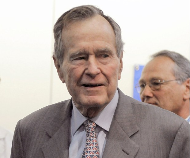 In a Tuesday, Dec. 2, 2008 photo, former President George H. W. Bush leaves a news conference at the Houston hospital where his wife Barbara has spent a week after surgery for a perforated ulcer. Another woman has stepped forward to accuse former President George H.W. Bush of inappropriately touching her. Roslyn Corrigan told Time magazine that she was 16 when Bush grabbed her buttocks as she posed for a photo with him in 2003 at a gathering of CIA officers north of Houston. (AP Photo/Pat Sullivan, File)