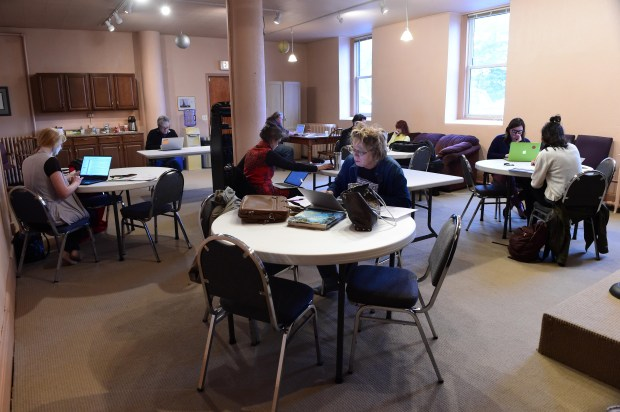 Writers, including Donna Isaac, center, work in the quiet together at the Blue Harbor Center for the Arts in St. Paul, Wednesday morning, Nov. 15, 2017. Operated by Tony Signorelli, the art center plans to offer comedy, poetry, music and spoken word shows, and offers space for writers to come together to work. (Scott Takushi / Pioneer Press)