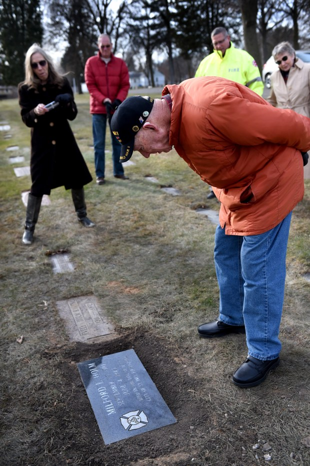 Walter Holm, looks at his brother's new gravemarker that indicates he was a firefighter who died in the line of duty, Wednesday, Nov. 22, 2017 at Elmhurst Cemetery in St. Paul. (Jean Pieri / Pioneer Press)