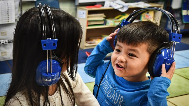 Aria Chuegheu, left, and Adrian Vang at free play time in Julie Heroff's preschool class at Castle Elementary School in Oakdale on Wednesday, Oct. 11, 2017. (Jean Pieri / Pioneer Press)