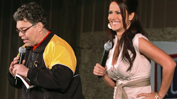 In this image provided by the U.S. Army, then-comedian Al Franken and sports commentator Leeann Tweeden perform a comic skit for service members during the USO Sergeant Major of the Army's 2006 Hope and Freedom Tour in Camp Arifjan, Kuwait, on Dec. 15, 2006. Sen. Al Franken, D-Minn., apologized Nov. 16, 2017, after Tweeden accused him of forcibly kissing her during the 2006 USO tour. Colleagues, including fellow Democrats, urged a Senate ethics investigation. Tweeden also accused Franken of posing for a photo with his hands on her breasts as she slept, while both were performing for military personnel two years before the one-time comedian was elected to the Senate. (Staff Sgt. Patrick N. Moes/U.S. Army via AP)