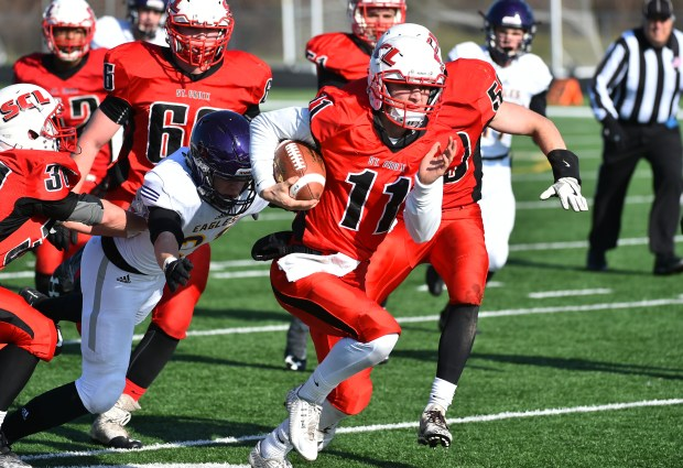 St. Croix Lutheran quarterback Jonathan Liesener races in for a touchdown against Rochester Lourdes in the first quarter in a Class 3A quarterfinal football game in Prior Lake Saturday, Nov. 11, 2017. (John Autey / Special to the Pioneer Press)