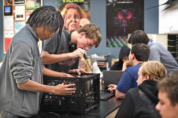 Jonathan Browne, left, and Alec Martsching fix a computer during Flex Time at Stillwater Area High School on Thursday, Nov. 16, 2017. (Jean Pieri / Pioneer Press)