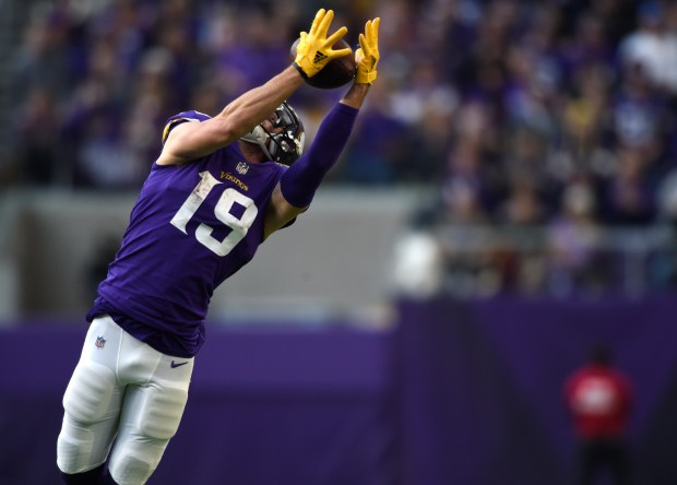 Adam Thielen #19 of the Minnesota Vikings leaps to catch the ball in the third quarter of the game against the Los Angeles Rams on November 19, 2017 at U.S. Bank Stadium in Minneapolis, Minnesota. (Photo by Hannah Foslien/Getty Images)