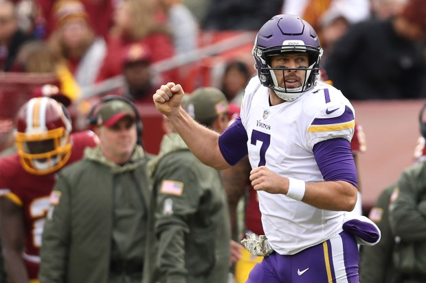 Quarterback Case Keenum #7 of the Minnesota Vikings celebrates after throwing a touchdown during the second quarter against the Washington Redskins at FedExField on November 12, 2017 in Landover, Maryland. (Photo by Patrick Smith/Getty Images)