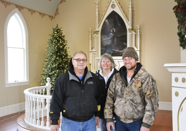 Three of the crew members who restored Farwell Norwegian Lutheran Church. From left: Fred Rodel of contractor Rodel Construction, artist Gloria Pfeifer, and Todd Loeffler, a contractor who said he was just providing labor in order to restore the building.(Karen Tolkkinen / Echo Press)