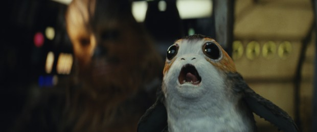 """Chewbacca, left, and a Porg in a scene from """"Star Wars: The Last Jedi."""" (Lucasfilm via AP)"""