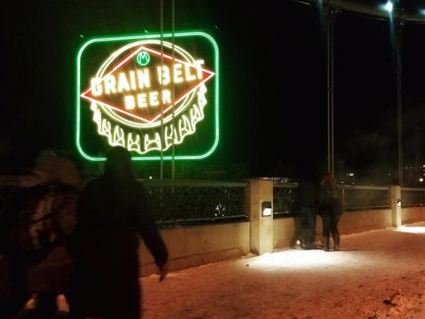 The landmark Grain Belt Beer sign is lit Dec. 30, 2017, after being dark since 1996. (Courtesy of Look & See Eye Care)