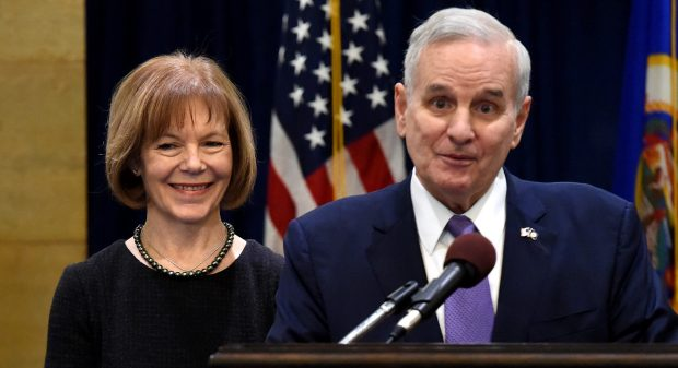 Governor Mark Dayton appoints Lt. Gov. Tina Smith to serve as U.S. Senator Wednesday, Dec. 13, 2017 at the State Capitol in St. Paul. Standing by her is her husband, Archie Smith. (Jean Pieri / Pioneer Press)
