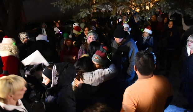 Friends and strangers gather at the East Side home of Miguel Gonzalez, 16, a Harding High School student who died after falling ill in September, to surprise Miguel's family with Christmas carols and and a truckload of presents on Thursday, Dec. 21, 2017. (Pioneer Press / John Autey)