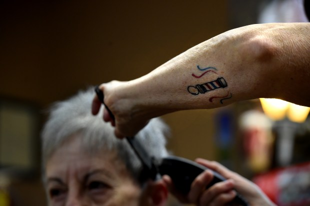 """I'm not a real tattoo person, but I feel like I earned that one,"" said Pat Link at Signal Barbers in West St. Paul Friday, Dec. 15, 2017. Link, 61, is marking 40 years at the shop. (Jean Pieri / Pioneer Press)"