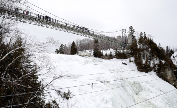 A bridge takes visitors over Montmorency Falls, at 272 feet, a waterfall (only partially frozen in winter) taller than Niagara Falls. (Brian Sirimaturos/St. Louis Post-Dispatch/TNS)