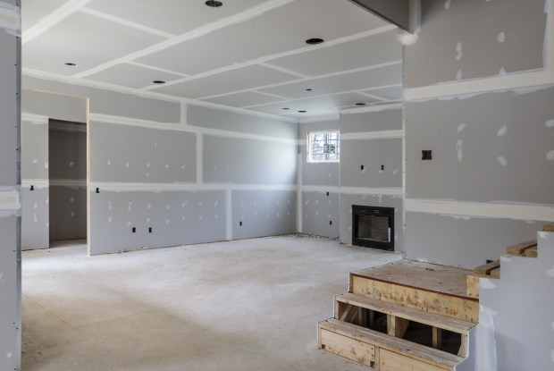 Most building codes require adequate headroom, stair clearance, and an exit point.