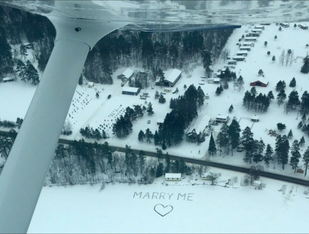 On Sunday, Jan. 7, 2018, Gavin Becker flew his longtime girlfriend, Olivia Toft, over the marriage proposal his family etched in the snow on Eighth Crow Wing Lake near Nevis, Minn. (Courtesy photo via Forum News Service)