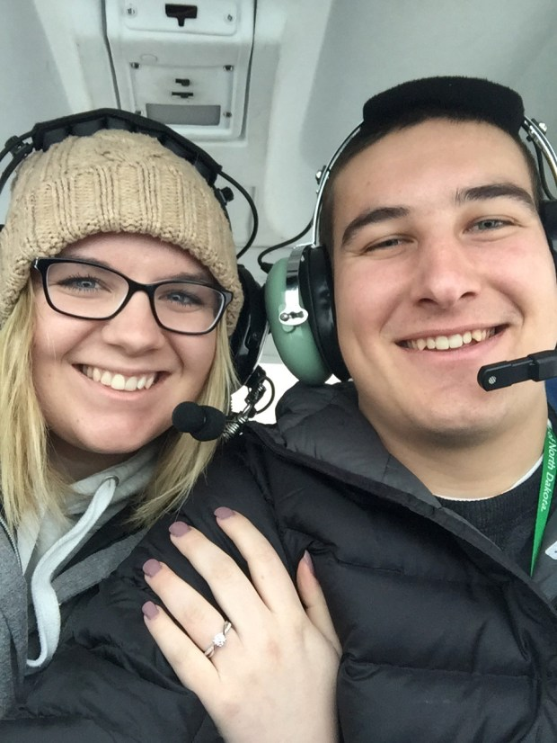 "She said ""yes!"" Gavin Becker and Olivia Toft take a selfie during his aerial proposal over Eighth Crow Wing Lake near Nevis, Minn., on Jan. 7, 2018. (Courtesy photo via Forum News Service)"