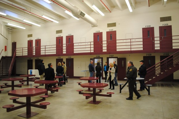 Tribune file/Visitors tour the Prairie Correctional Facility prior to a community meeting held in Appleton in February 2017 where over 300 people came out to show support for its re-opening. The tour participants are in one of the pods holding cells for 40 inmates.