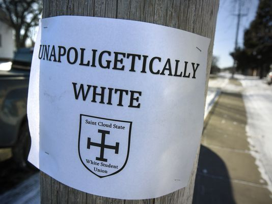 A sign is posted to a pole along West Ash Street Wednesday, Jan. 17, near the post office in St. Joseph, Minn. The sign was one of dozens posted in St. Joseph. (Dave Schwarz / St. Cloud Times via Forum News Service)