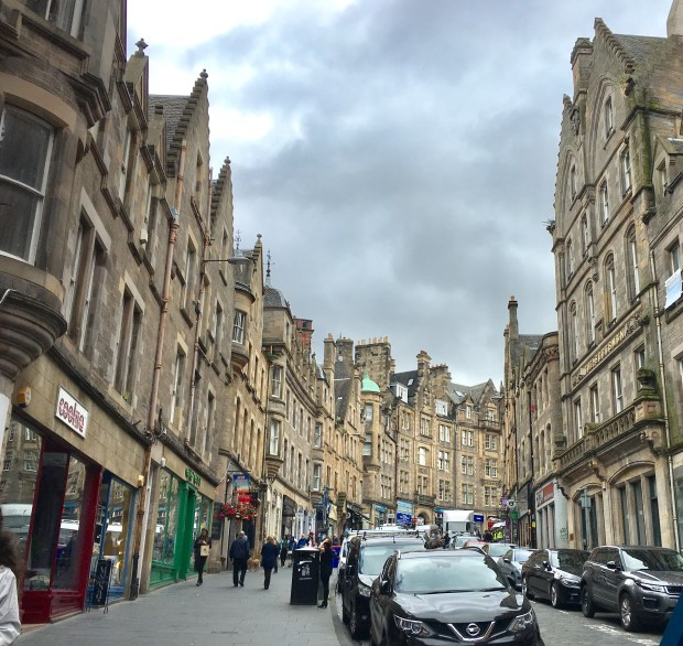 One of the typical residential-and-retail streetscapes in the Scottish capital of Edinburgh, with buildings of mottled stone blocks. (Tom Shroder / Special to the Washington Post)