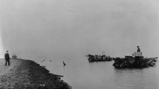 People drove their cars into the lake to escape the flames around Moose Lake. (Courtesy of Minnesota Historical Society Collections)