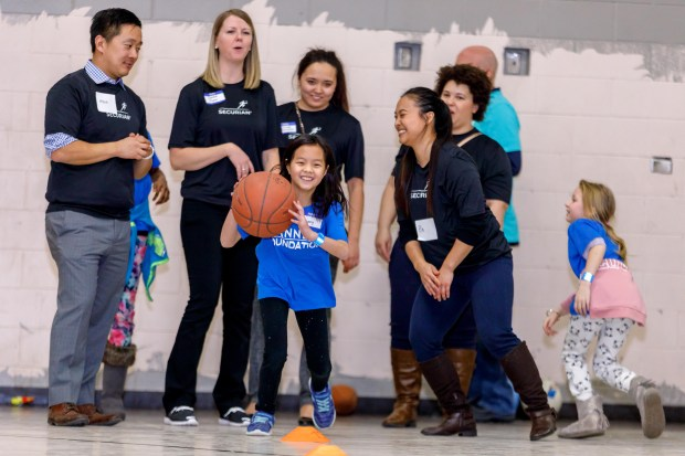A child plays sports with other children and volunteers at Conway Community Center on Tuesday, Jan. 10, 2018. The gym will be getting a makeover following a $50,000 grant awarded to The Sanneh Foundation by the Minnesota Super Bowl Host Committee. (Courtesy of Steffenhagen Photography)