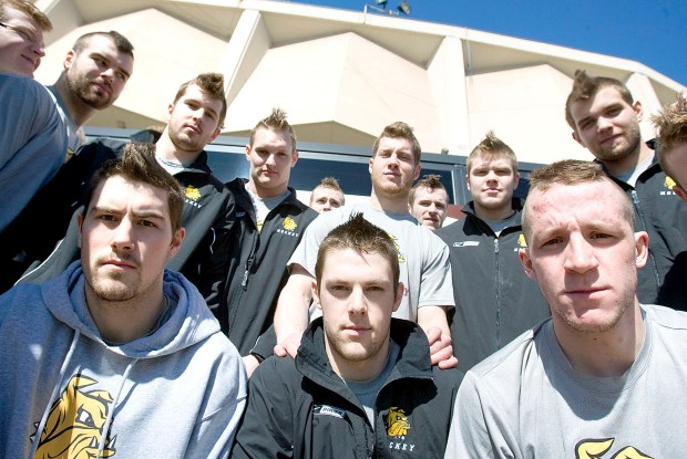 The University of Minnesota Duluth men's hockey team members, including captains Josh Meyers (front left), Matt Greer and Andrew Carroll, all sport Mohawks for their games in St. Paul this week. The team left for St. Paul around noon, and will play in the conference WCHA Final Five starting tomorrow. (Amanda Hansmeyer / ahansmeyer@duluthnews.com)