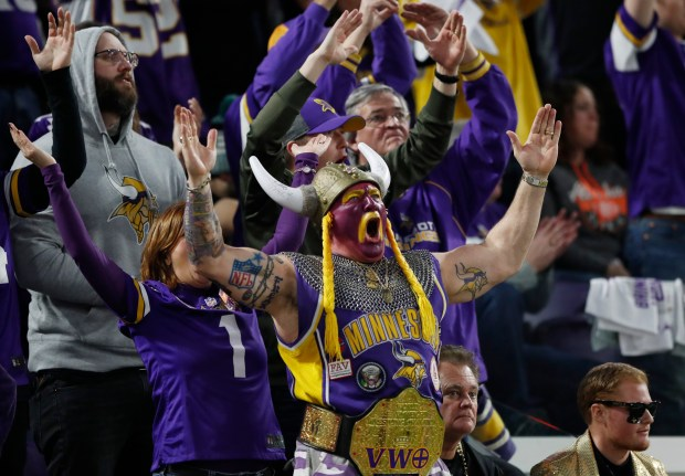Minnesota Vikings fans cheer during the first half of an NFL divisional football playoff game against the New Orleans Saints in Minneapolis, Sunday, Jan. 14, 2018. (AP Photo/Charlie Neibergall)