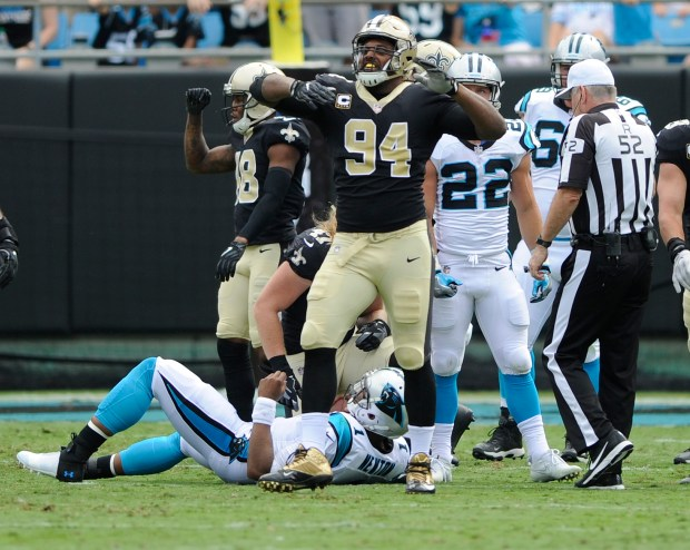 FILE - In this Sunday, Sept. 24, 2017, file photo, New Orleans Saints' Cameron Jordan (94) celebrates after sacking Carolina Panthers' Cam Newton (1) in the first half of an NFL football game in Charlotte, N.C. Holiday cheer could be in order in New Orleans, Carolina, Atlanta, Los Angeles and Kansas City this weekend. (AP Photo/Mike McCarn, File)