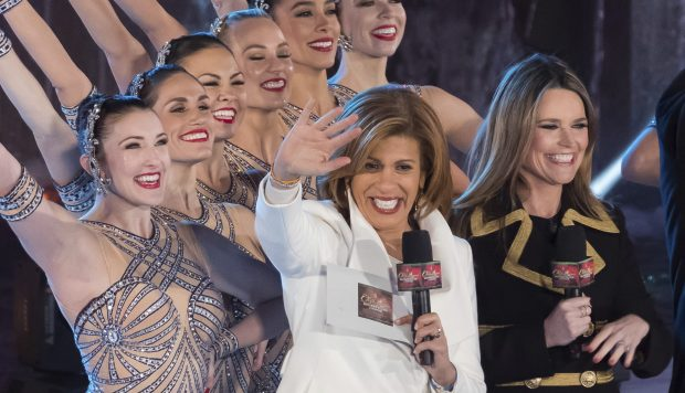 "In this Nov. 29, 2017, photo, Savannah Guthrie, right, and Hoda Kotb appear with the Rockettes during the 85th annual Rockefeller Center Christmas Tree lighting ceremony in New York. NBC News opened the new year by appointing Kotb as co-anchor of the ""Today"" show's first two hours with Guthrie, replacing Matt Lauer following his firing on sexual misconduct charges in late November.  (Photo by Charles Sykes/Invision/AP)"