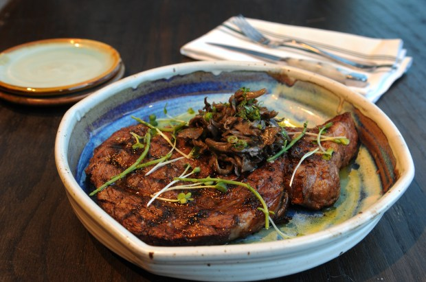 A rib eye steak is served at Octo Fishbar, a new seafood restaurant in Lowertown at 289 E. Fifth Street in the Market House Collaborative, which opened in October and is located in the old Heartland space. They are open for dinner seven nights a week. (Ginger Pinson / Pioneer Press)