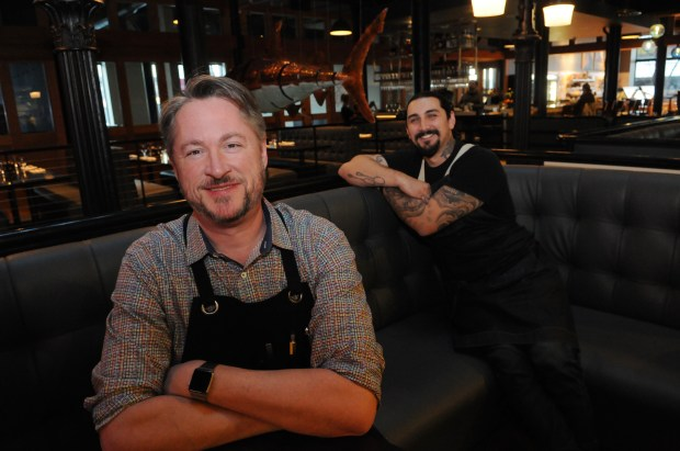 Tim McKee, the visionary behind Market House and Octo Fishbar, front, sits in his restaurant with chef de cuisine Shane Oporto, right, at Octo Fishbar, a new seafood restaurant in Lowertown at 289 E. Fifth Street in the Market House Collaborative, which opened in October and is located in the old Heartland space. The restaurant is open for dinner seven nights a week. (Ginger Pinson / Pioneer Press)