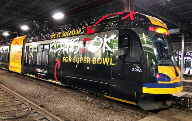 "These ""wrapped"" Metro Transit light rail trains will be seen starting later this week to serve as a reminder to visitors, fans, and the local community that Metro Transit is a way for people to get to their destinations during Super Bowl events. (Courtesy of Metro Transit)"