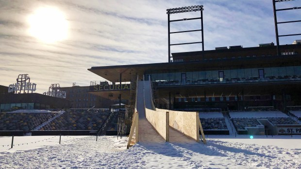 The St. Paul Saints, who have held concerts, tailgating and winter baseball games in January, have really gone downhill this winter. CHS Field has a Super Slide snow slide that starts at the second story patio of the Securian Club set up to celebrate the Super Bowl and the Winter Carnival in St. Paul. (Pioneer Press / Julio Ojeda-Zapata)