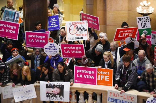 People hold signs at the State Capitol in St. Paul during a Minnesota Citizens Concerned for Life rally on Monday, Jan. 22, 2018, the 45th anniversary of the Jan. 22, 1973 Roe V. Wade decision from the U.S. Supreme Court regarding abortion. (John Autey / Pioneer Press)