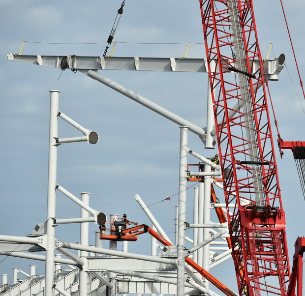 Construction crews lift the first roof truss into place at the site of the new Allianz Stadium in St. Paul on Monday, Jan. 8, 2018. (Pioneer Press / John Autey)