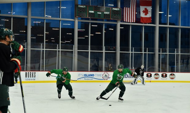 Forward Jason Zucker pushes the puck up ice followed by fellow forward Mikael Granlund during the Minnesota Wild's first practice on their new practice facility, the TRIA Rink at Treasure Island Center in St. Paul on Wednesday Jan. 24, 2018. (John Autey / Pioneer Press)