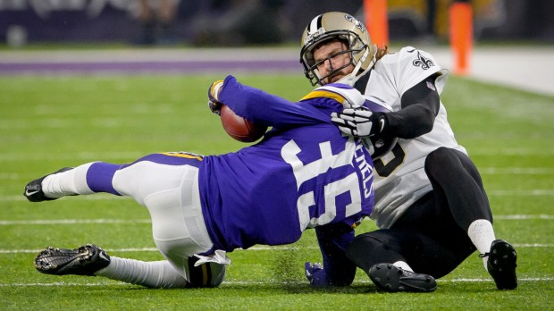 New Orleans Saints punter Thomas Morstead (6) injured his ribs on this touchdown-saving tackle of Minnesota Vikings cornerback Marcus Sherels (35) in the first half of an NFC divisional playoff NFL football game in Minneapolis, Minn. Sunday, Jan. 14, 2018. (Associated Press photo)