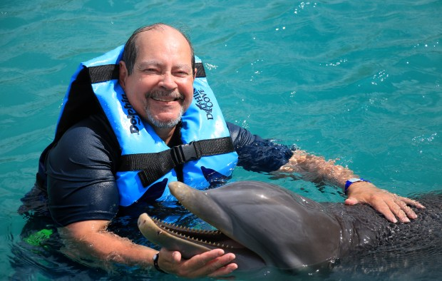 Pioneer Press columnist Ruben Rosario poses with a dolphin during a trip to Jamaica in Dec. 2017. (Ruben Rosario / Pioneer Press)