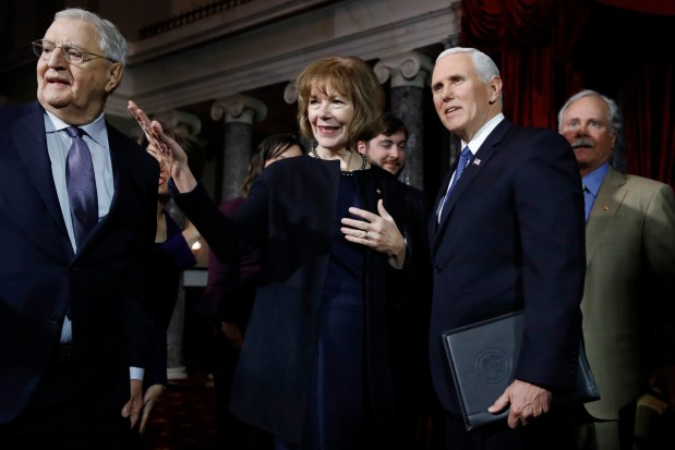 Vice President Mike Pence, right, stands with Sen. Tina Smith, D-Minn., center, and former Vice President Walter Mondale, left, before administering the Senate oath of office during a mock swearing in ceremony in the Old Senate Chamber Wednesday, Jan. 3, 2018 on Capitol Hill in Washington. (AP Photo/Jacquelyn Martin)