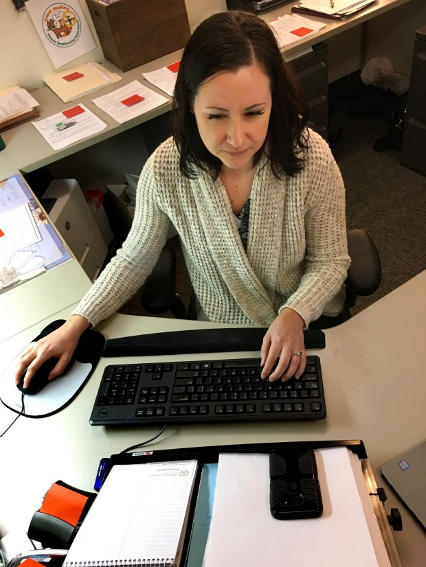 Aimee Schroeder combs the internet in her Stillwater office on Jan. 9, 2018, looking for sex-for-sale ads that might involve children. Schroeder is an analyst with Washington County attorney's office, working with the East Metro Human Trafficking Task Force. (Bob Shaw / Pioneer Press)