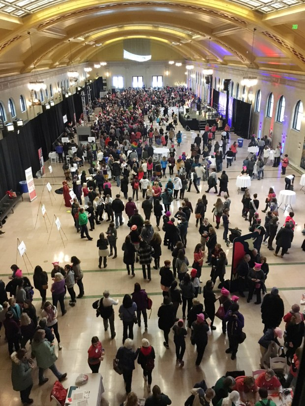 A crowd fills the Union Depot in St. Paul on Sunday, Jan. 21 as they listen to speakers during the 'Hear Our Voices' event sponsored by Women's March Minnesota. The group sold out the event with 2500 people buying tickets. Those who attended signed up to volunteer, listened to speakers and met elected officials. January 21, 2018 marked the one year anniversary of the birth of the Women's March movement. Weekend events were held nationwide in cities across the country. (Kristi Belcamino / Pioneer Press)