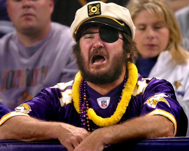 Minnesota Vikings fan Dan Mathews wears a captain's hat during the team's first home game after an Oct. 6, 2005, team cruise on Lake Minnetonka that allegedly involved strippers, lap dances and sexual contact. (Sherri LaRose-Chiglo / Pioneer Press)