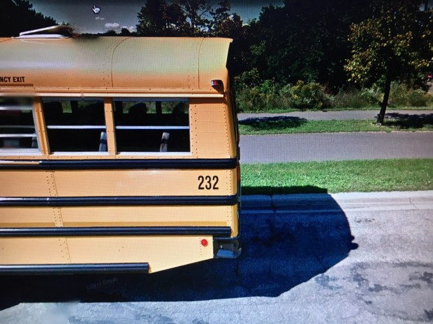 A screenshot of Google street view, in front of Harriet Island Regional Park in St. Paul. The bus bears the number 232, referenced in Clue 5. (Courtesy of Google)